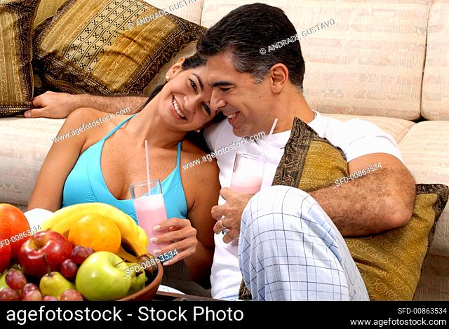 Young couple holding cocktails