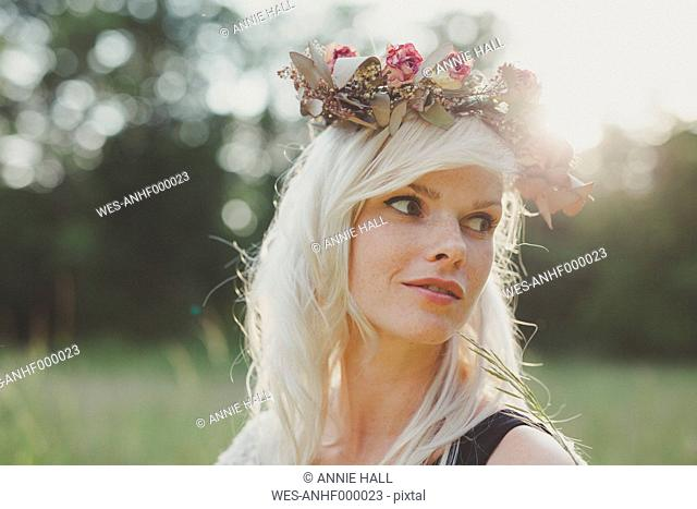 Girl with flowers in her hair during sunset