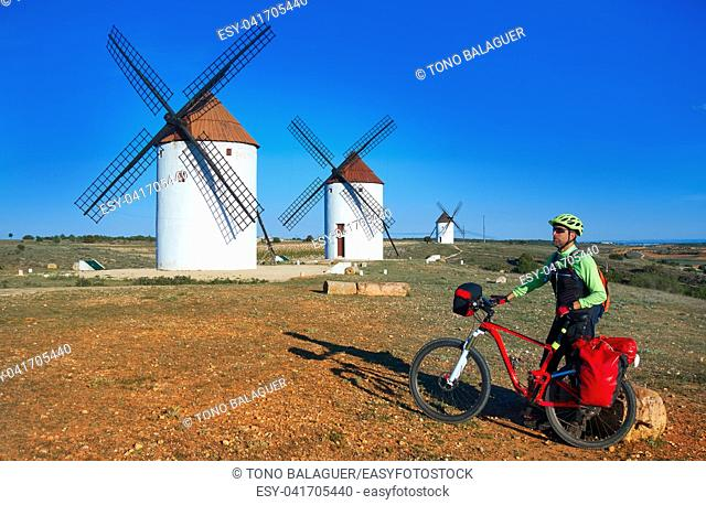 Mota del Cuervo windmills pilgrim biker in Cuenca at Castile la Mancha of spain