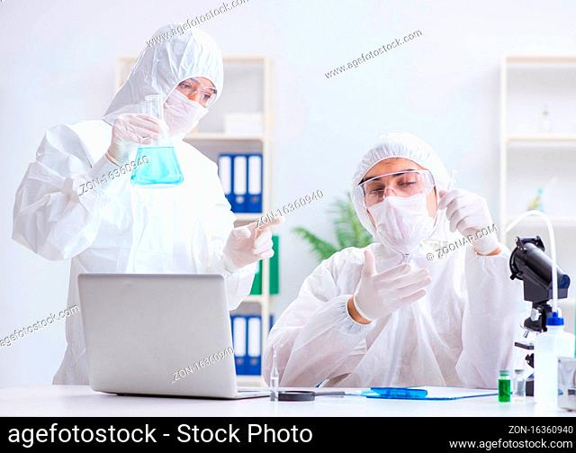 The two scientists working in the chemical lab
