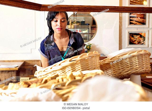 Customer in bakery looking at baked goods