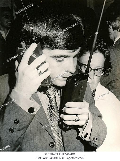 Student speaking into two walkie talkie radios at once during an anti Vietnam War student sit-in protest at North Carolina State University, Raleigh