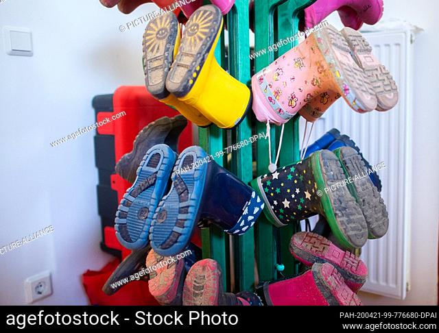 21 April 2020, Lower Saxony, Hanover: Children's rubber boots hang in a kindergarten in the Hannover region. The Diakonie in Lower Saxony sees a considerable...