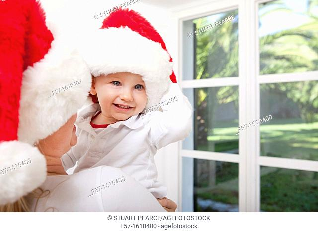 Mother and child wearing Santa hats