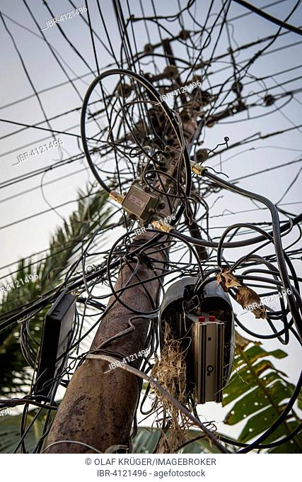 Electrical cables, tangled wires on a pylon, Kochi, Cochin, Kerala, India