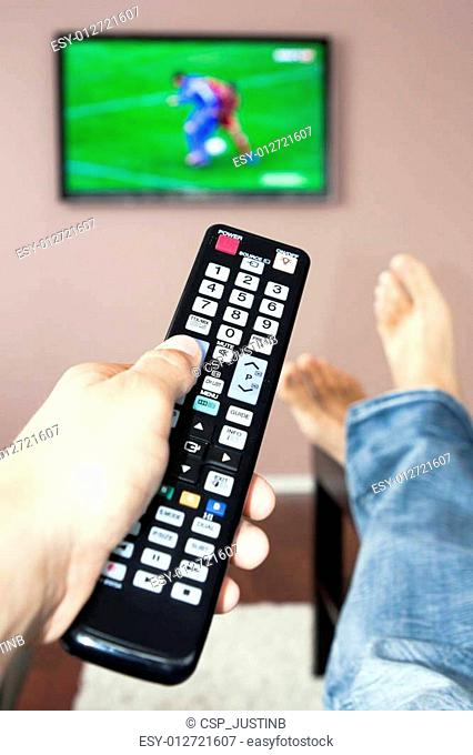 Men with the remote control, front of the television