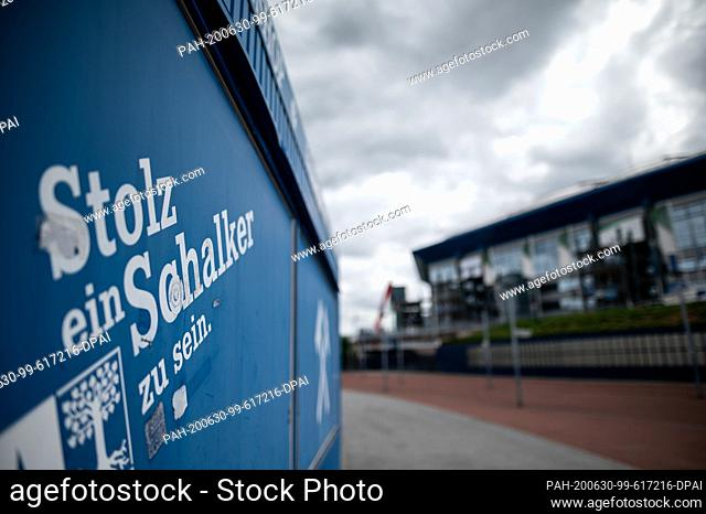 """30 June 2020, North Rhine-Westphalia, Gelsenkirchen: On a cashier's desk in front of the Veltins-Arena in Gelsenkirchen it says """"""""Proud to be a rogue"""""""""""