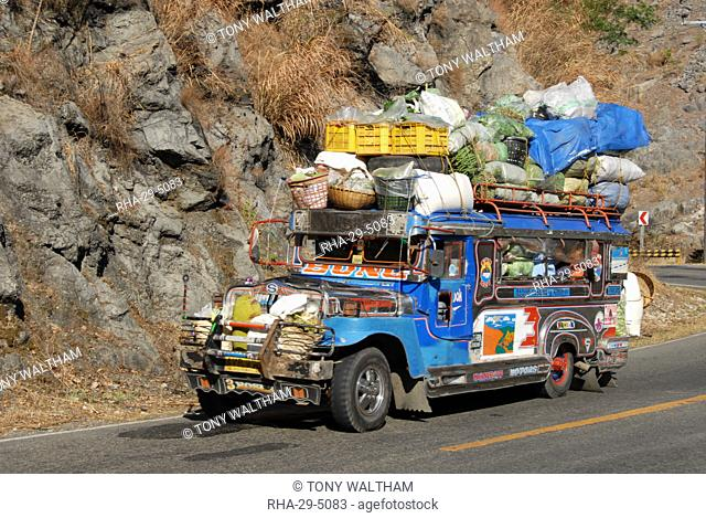 Heavily loaded jeepney, a typical local bus, on Kennon Road, Rosario-Baguio, Cordillera, Luzon, Philippines, Southeast Asia, Asia