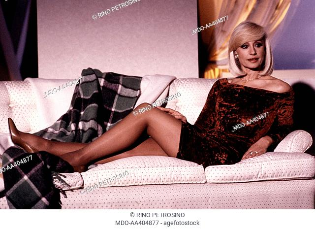 Raffaella Carrà lying down in a sofa. Italian TV presenter, actress, singer and showgirl Raffella Carrà (Raffaella Maria Roberta Pelloni) lying on a sofa