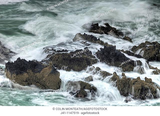 Surf breaking over rocks, Tumbledown Bay, Banks Peninsula, Canterbury, New Zealand