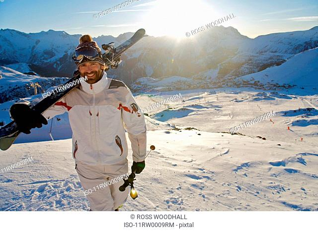 Portrait of a skier at sunset