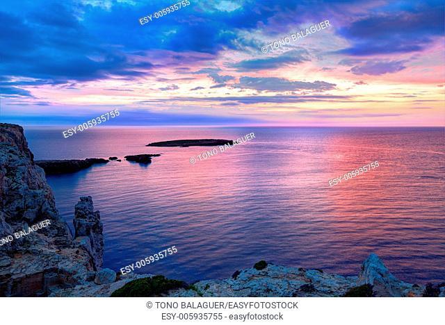 Menorca sunset in Cap de Caballeria cape at Balearic Islands es Mercadal