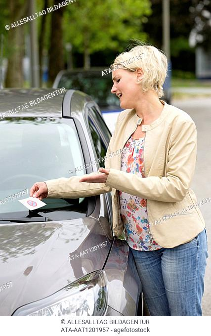 Female car driver gets a fine