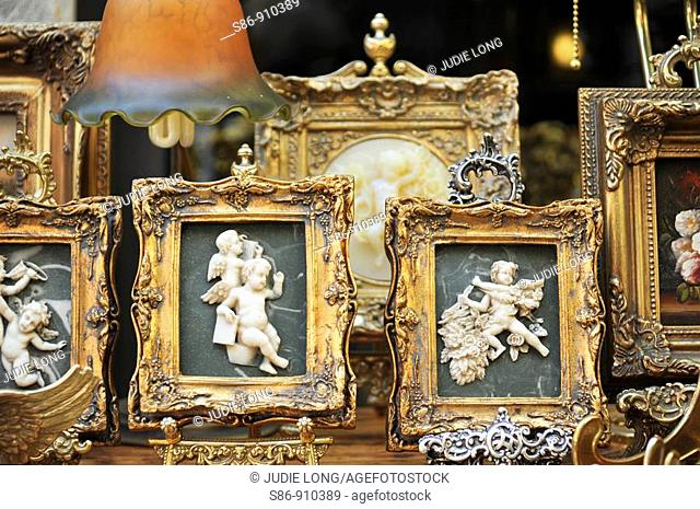Cameo Pictures displayed at an outdoor antique shop
