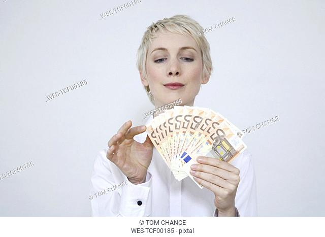 Young woman holding money, portrait