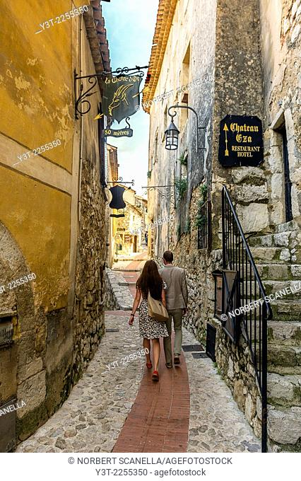 Europe, France, Alpes-Maritimes. Eze. The famous perched village. Couple Tourists walking in a alley