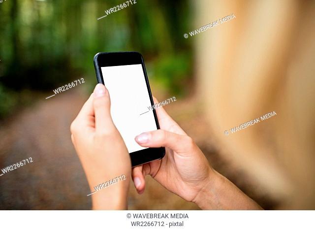 Beautiful blonde woman using smartphone