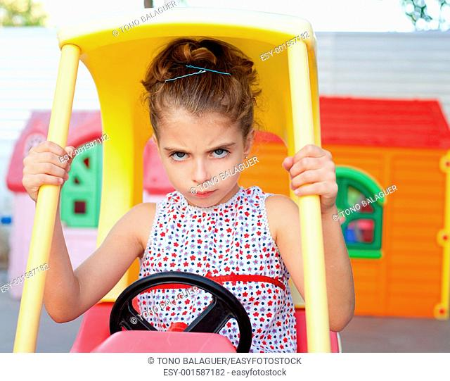 Angry toy car driver children girl in playground