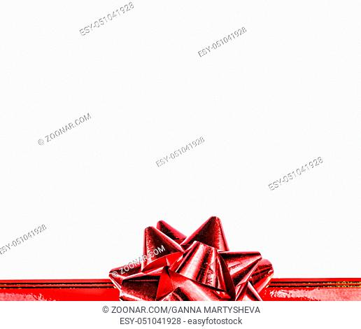 A holiday symbol, an element of decor.Red bow and ribbon isolated on white background