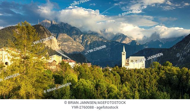 Evening sunlight over Chiesa di San Martino and the Dolomite Mountains near Venas di Cadore, Veneto, Italy