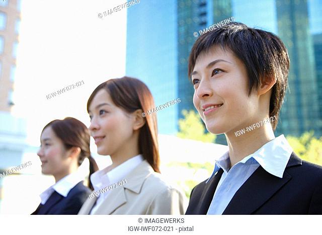 Japan, Honshu, Tokyo, Businesswomen smiling