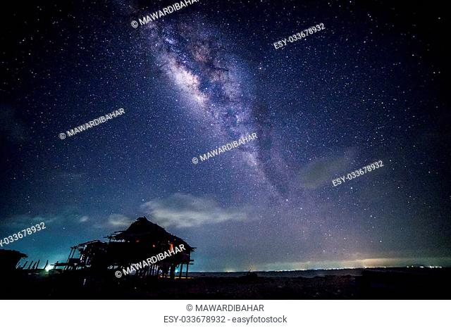 Milkyway with house foreground at Maiga Island, Sabah, Malaysia. Slightly noise due to high ISO