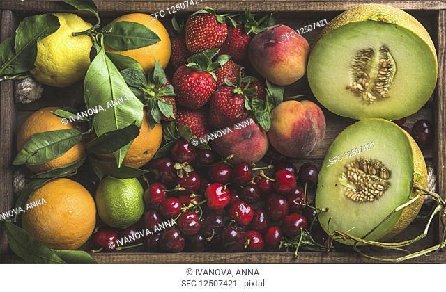 Healthy summer fruit variety - Melon, sweet cherries, peach, strawberry, orange and lemon