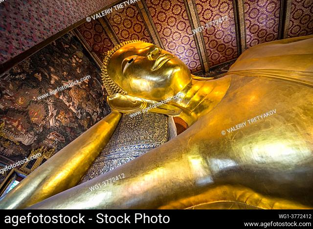 Bangkok, Thailand - December 7, 2019: Golden Buddha statue in Thailand Buddha Temple Wat Pho (Temple of the Reclining Buddha), Asian style Buddha Art