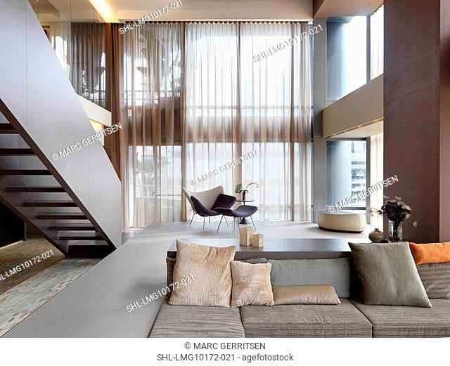 Built in sofa and staircase in modern home