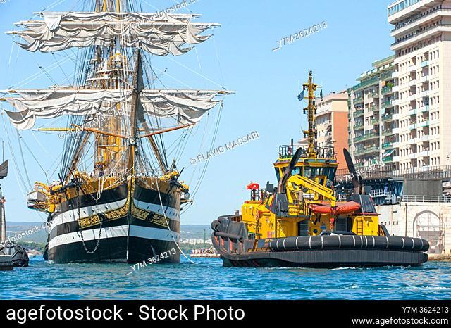 "22 August 2020 - Tug Boat """"Dritto"""" assist the mooring of the tall ship â. œAMERIGO VESPUCCIâ. . on the dock of Aragonese Castle of Taranto"