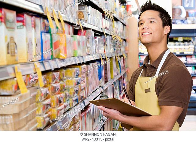 Sales assistant doing a stocktake