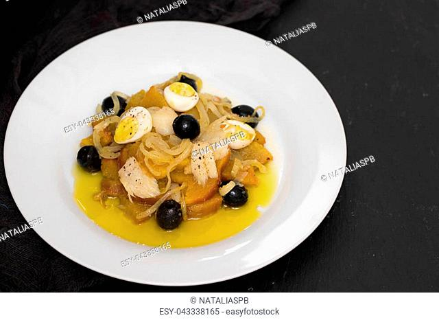 sweet potato with cod fish, onion and eggs on dish