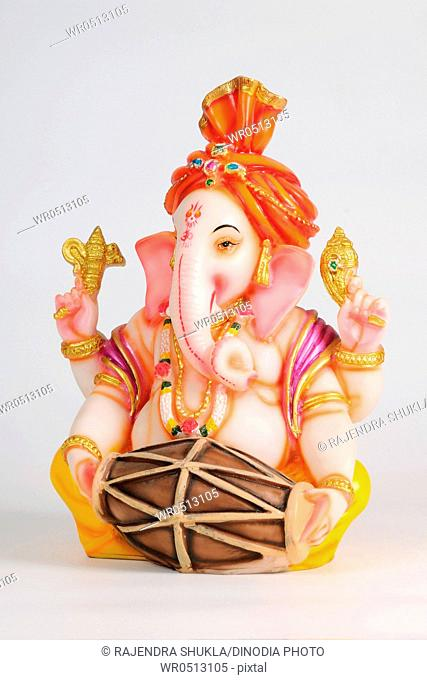 Statue of lord ganesh playing mridung , India
