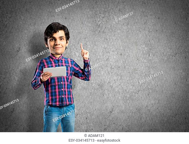 Funny bigheaded student with tablet in hands pointing with finger up