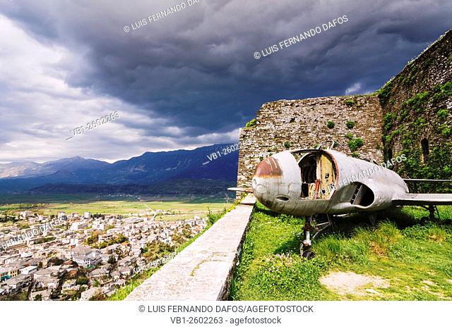 Shell of a 1957 US military jet at the ramparts of the Girokaster castle which hosts the Albanian National Armaments Museum. City overview