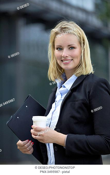 Portrait of a executive woman with coffee outdoors