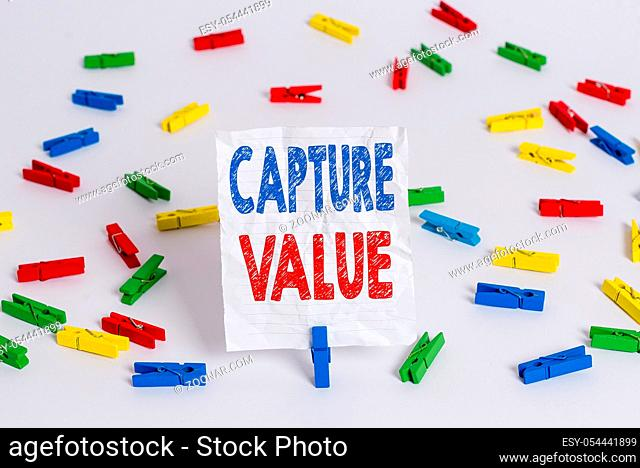 Text sign showing Capture Value. Business photo showcasing Customer Relationship Satisfy Needs Brand Strength Retention Colored clothespin papers empty reminder...