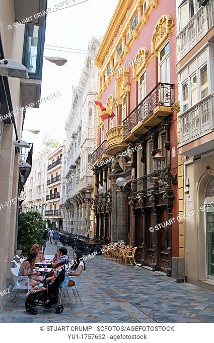 Main street with many shops and pavement cafes at Cartagena in the region of Murcia, Spain