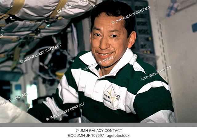 Astronaut Mamoru Mohri, mission specialist, supports SRTM's Blue Team on Endeavour's mid deck. He is with Japan's National Space Development Agency (NASDA)