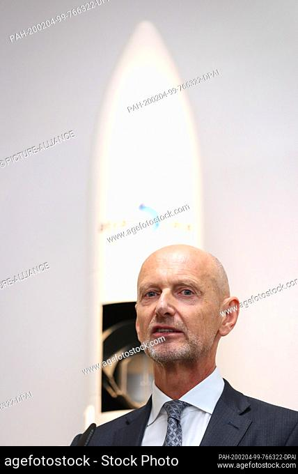 03 February 2020, Bavaria, Augsburg: Hans Steininger, Management Board member of MT Aerospace, is standing in front of the model of an Ariane 6 rocket