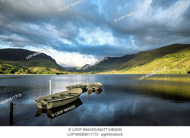 View of rowing boats on Llyn Nantlle in Snowdonia National Park at sunset