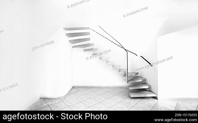 twisted staircase in clean white building leading up to second floor with white walls