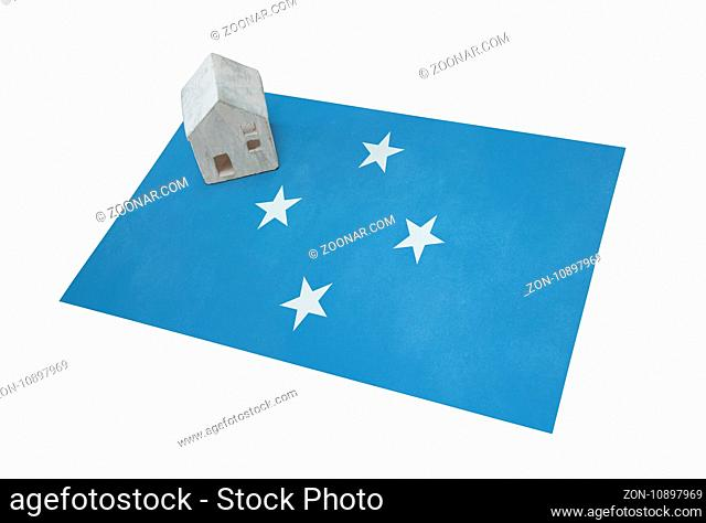 Small house on a flag - Living or migrating to Micronesia