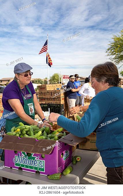 Marana, Arizona - Volunteers from St. Christpher Catholic Parish distribute produce provided by the Borderlands Food Bank