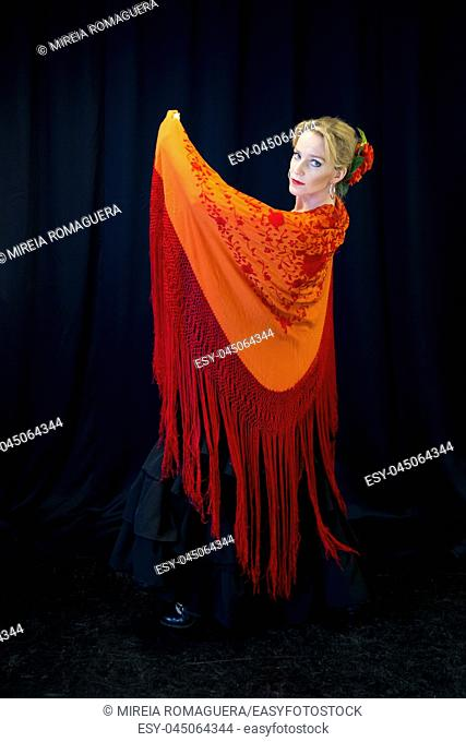 Flamenco dancer dressed with red shawl