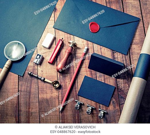 Blank vintage corporate stationery set on wooden background. Template for branding design. Flat lay