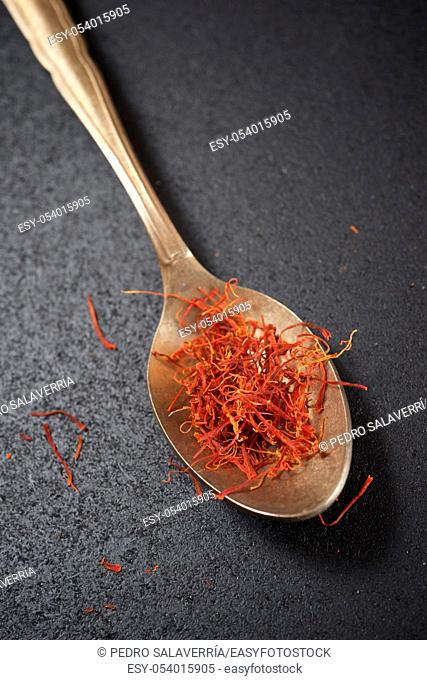Saffron in a small metallic spoon
