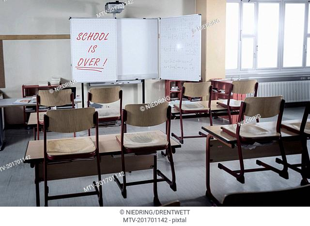 Desks and chairs in empty classroom, Bavaria, Germany