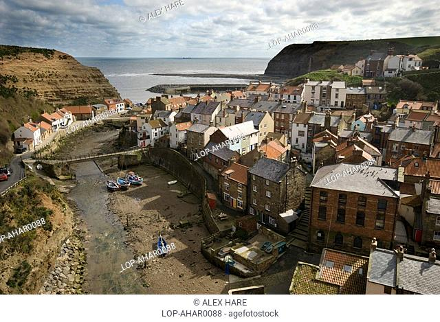 England, North Yorkshire, Staithes, A view over the traditional fishing village of Staithes from the northern cliff side