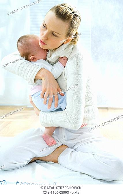 mum hugging baby